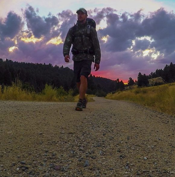 vibrant sunset cdt hiker montana
