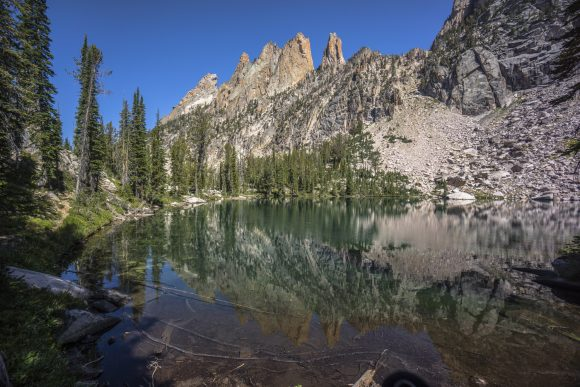 clear lake refelction of jagged mountain peaks