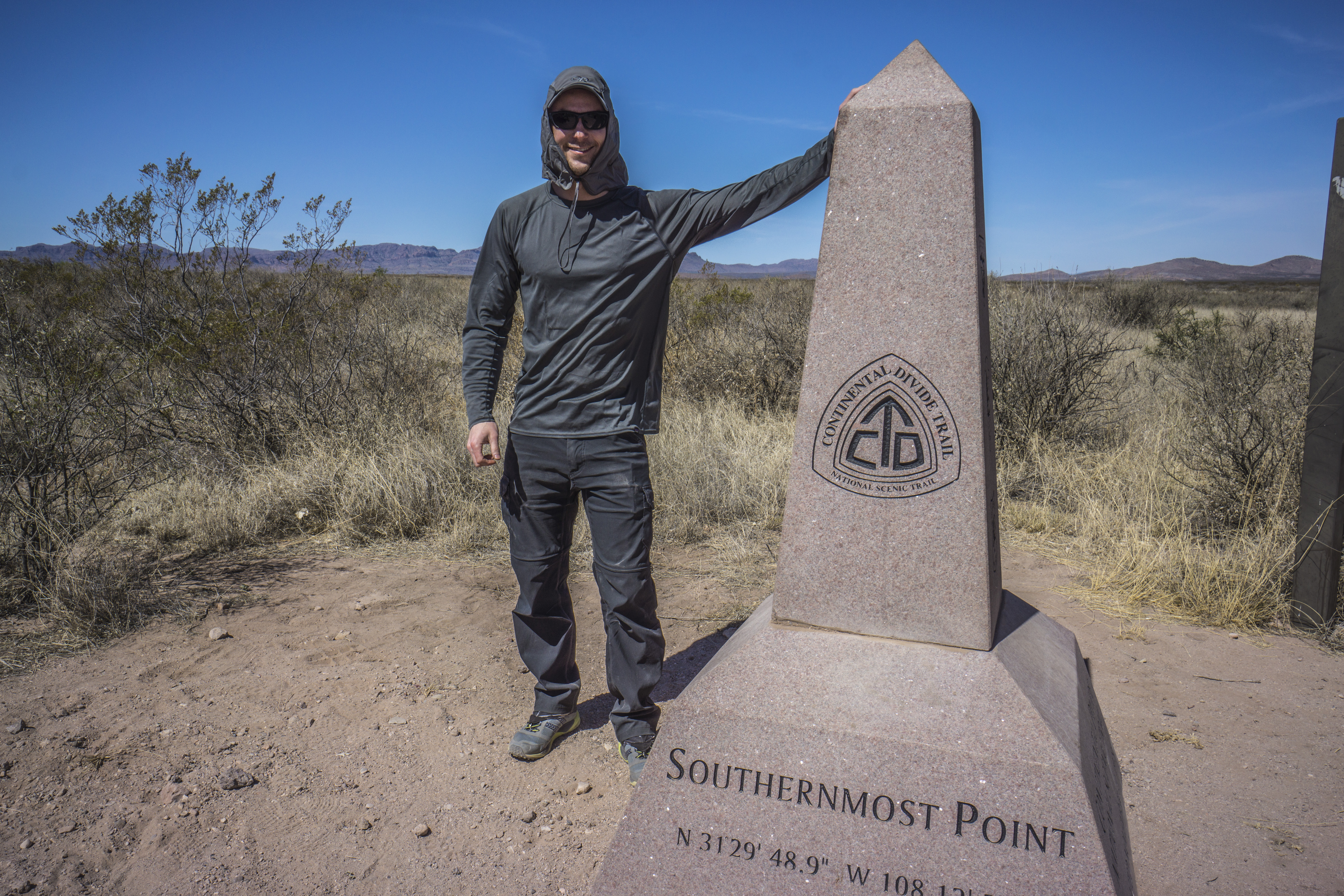 cdt trail journal - hiker at the southern terminus crazy cook monument at the mexico border