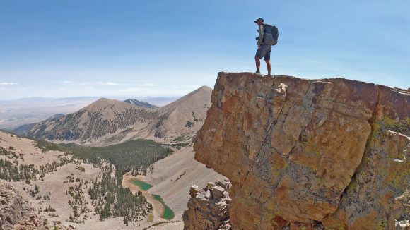 hiker walks ridgeline in great basin national park on thru hike of the basin and range trail in nevada